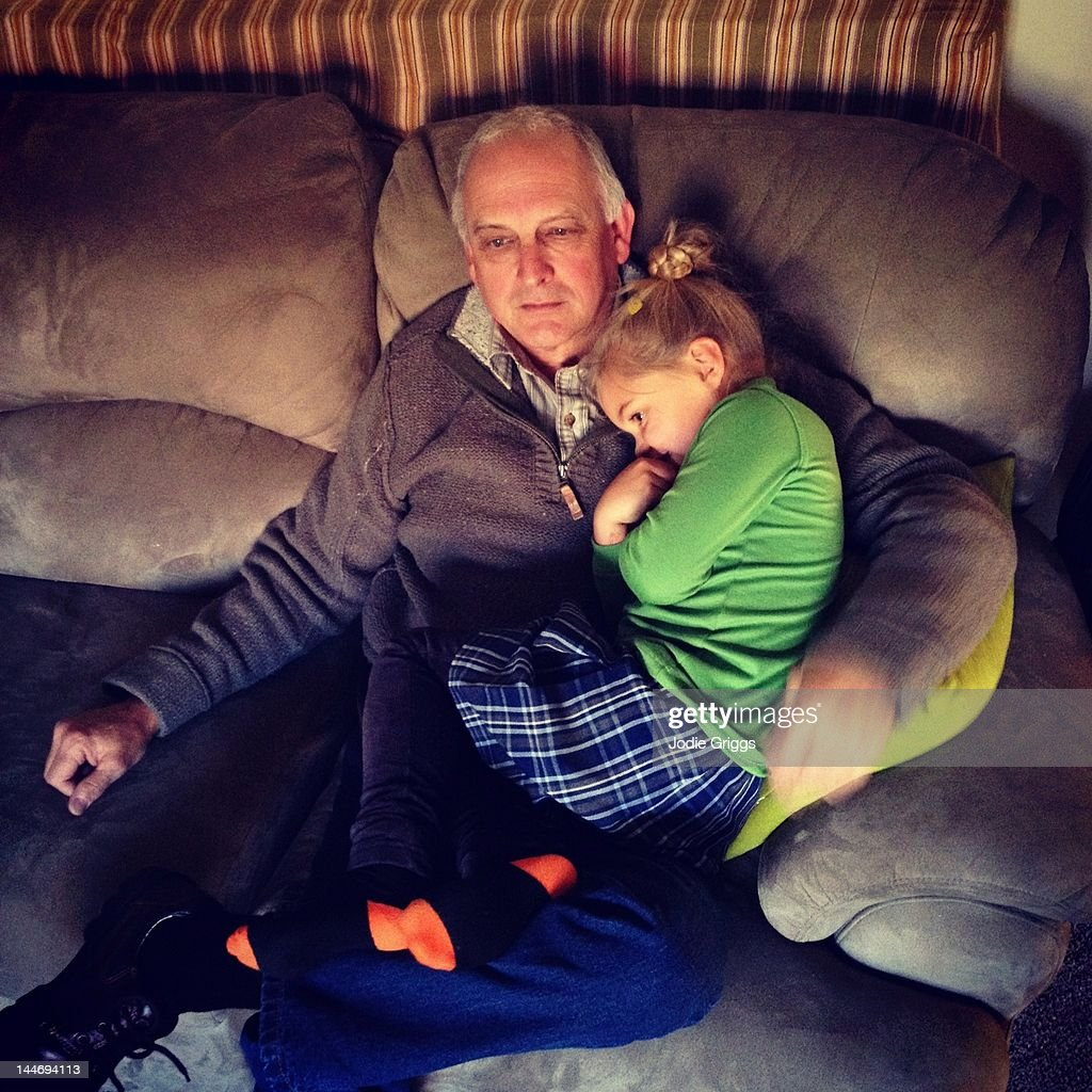 Grandfather and Grandchild having cuddle : Stock Photo