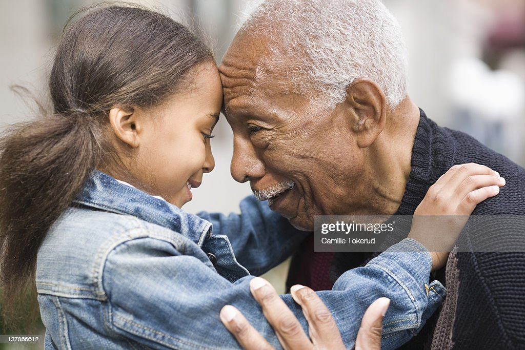 Grandfather and granddaughter face to face