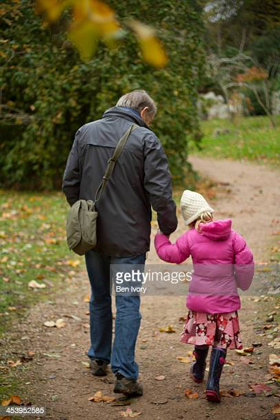 Grandfather and granddaughter in Autumn
