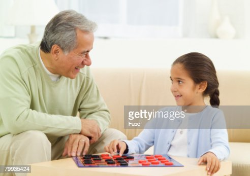 Grandfather and Granddaughter Playing Checkers