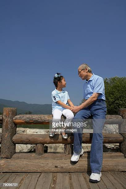 A grandfather and granddaughter spending quality time together.