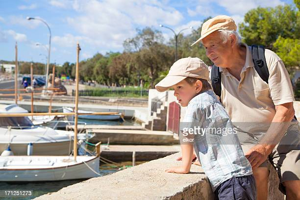 Grandfather And Grandson at Waterfront in Harbour
