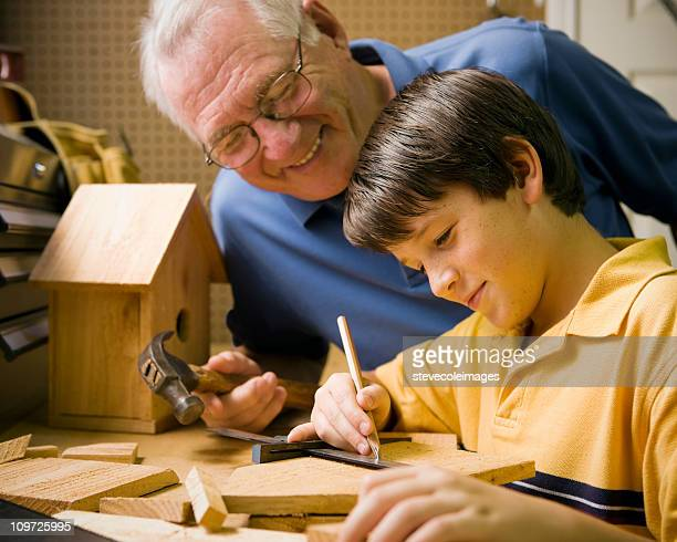 Grandfather and Grandson Building Birdhouse