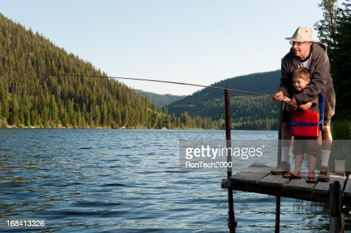 Grandfather and grandson fishing together stock photo for What age do you need a fishing license