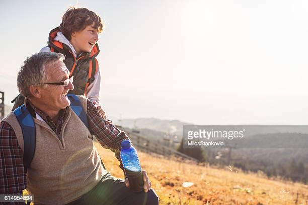 Grandfather and grandson in nature