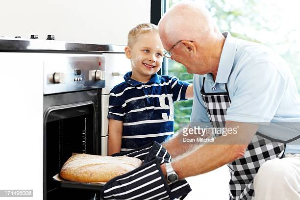 Grandfather and grandson making bread