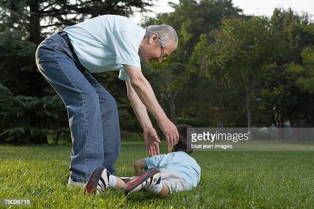 A grandfather and grandson play together.