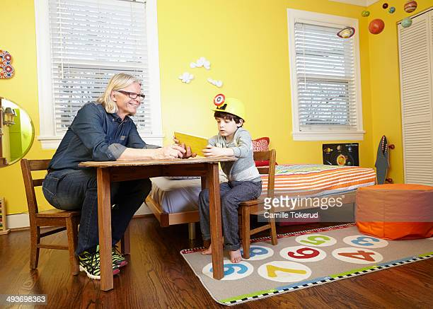 Grandfather and grandson playing at room