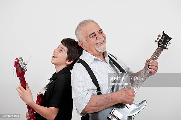 Grandfather and Grandson playing guitars