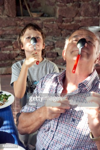 grandfather and grandson playing with spoons : Stock Photo