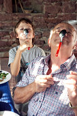 grandfather and grandson playing with spoons