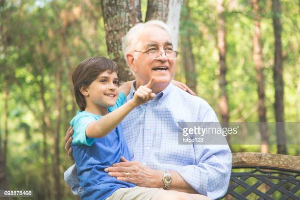 Grandfather and grandson share memories outdoors.