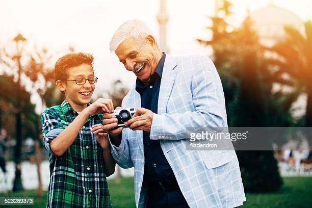 Grandfather And Grandson taking pictures