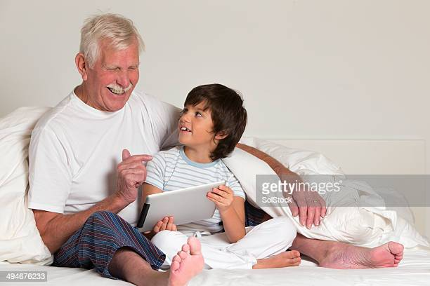 Grandfather and Grandson Using Digital Tablet