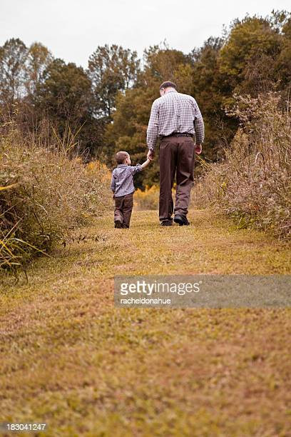 Grandfather and grandson walking away