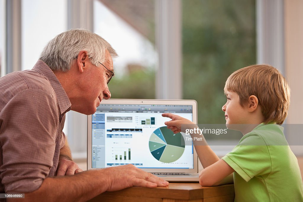 A grandfather and grandson with laptop. : Stock Photo