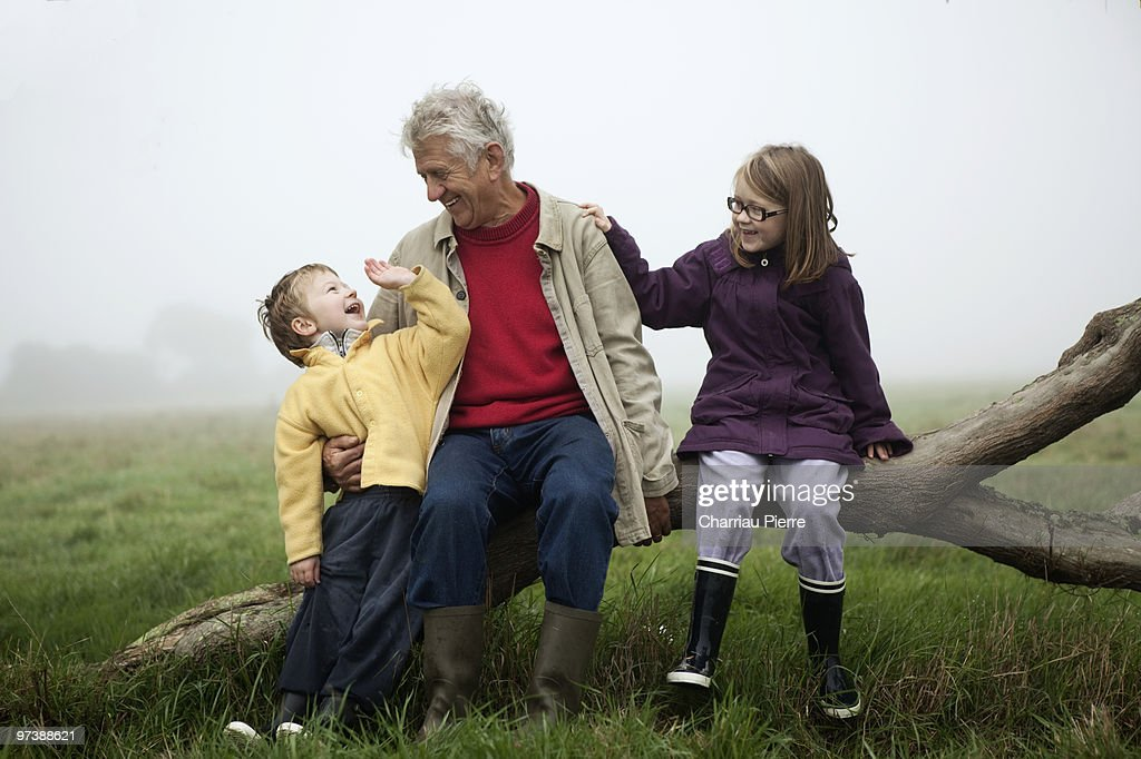 grandfather and his grandchildren in the countrysi : Stock Photo