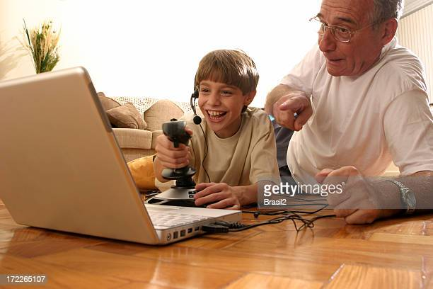 A grandfather and his grandson enjoying video games