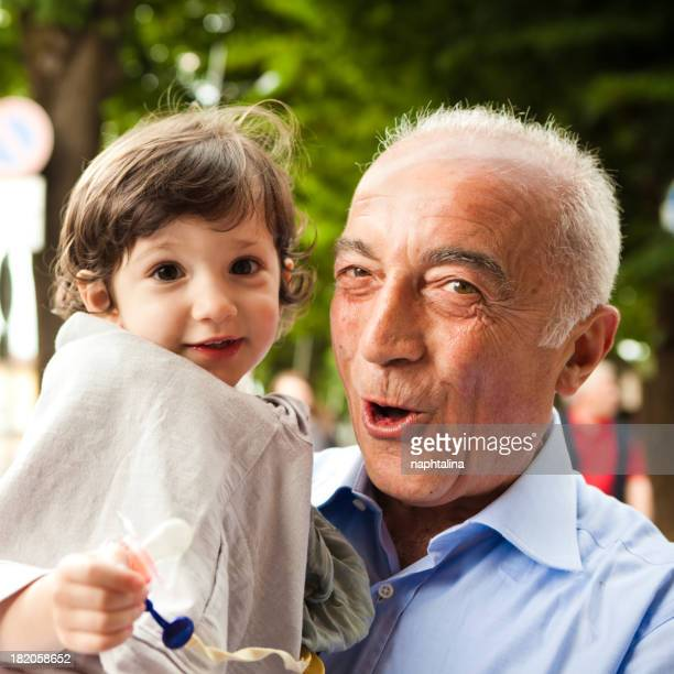 Grandfather and niece smiling at camera