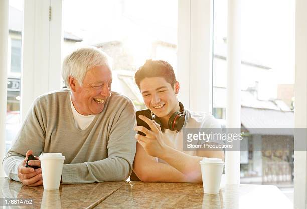 Grandfather and teenage Grandson using technology