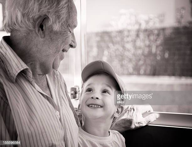 Grandfather And Three-Years-Old Grandson Laughing Together