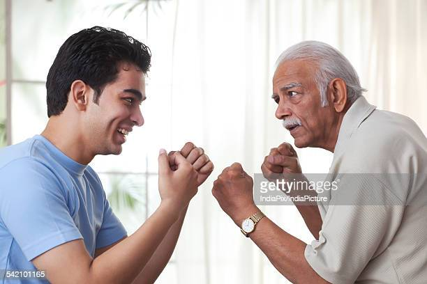 Grandfather boxing with grandson