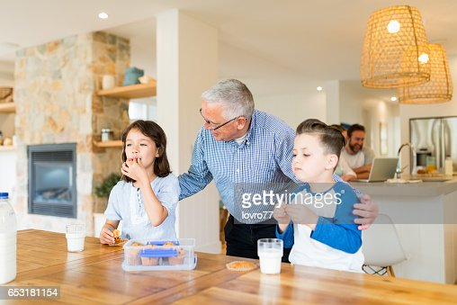 Grandfather brought grandchildren homemade biscuits : Stock Photo