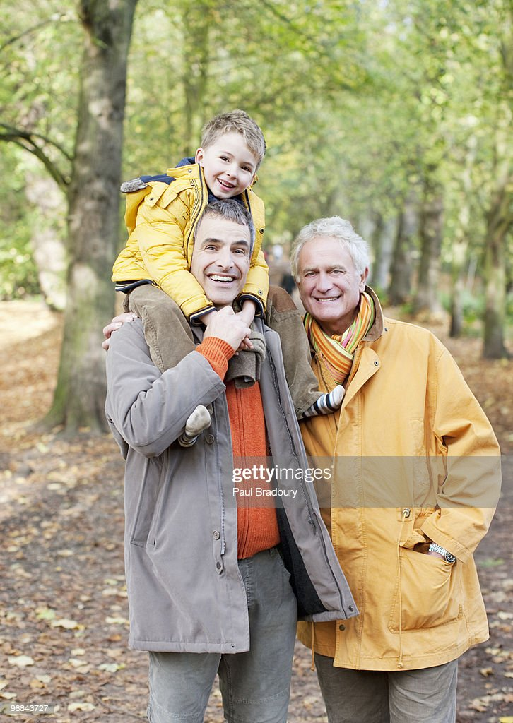 Grandfather, father and son walking outdoors : Stock Photo