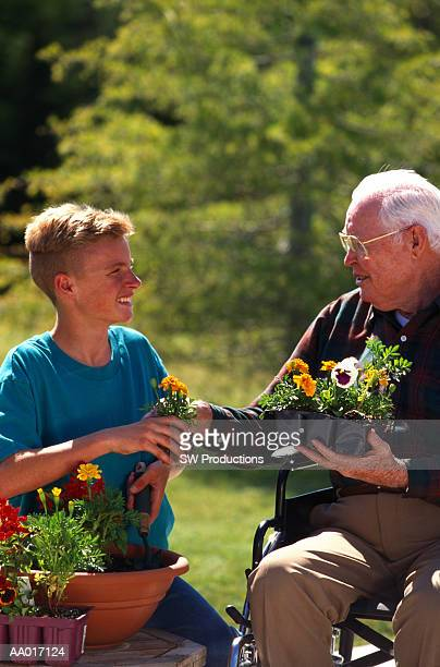 Grandfather Giving Grandson a Plant
