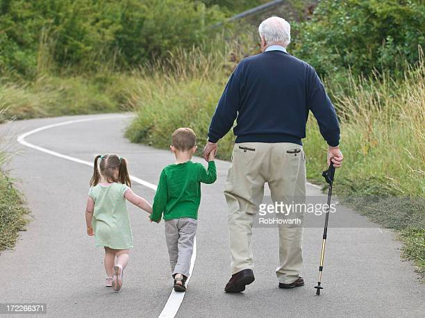 Grandfather going on a walk with his grandchildren