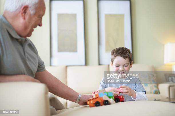 Grandfather playing with grandson