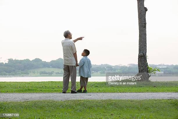 Grandfather pointing something out to grandson