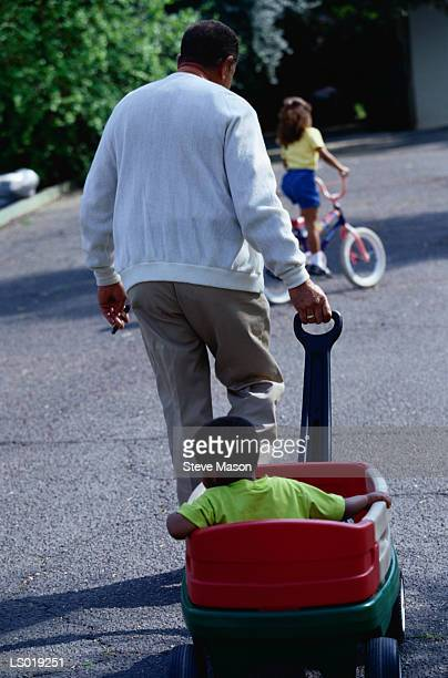 Grandfather Pulling Wagon