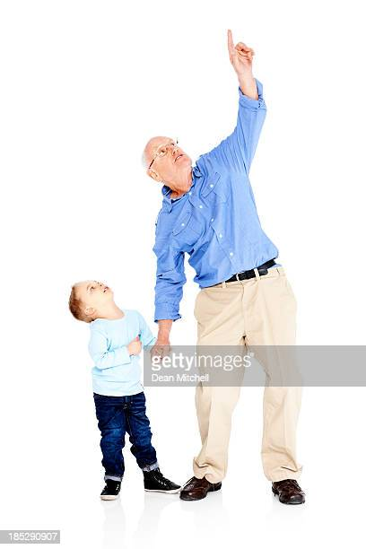Grandfather showing something interesting to his grandson