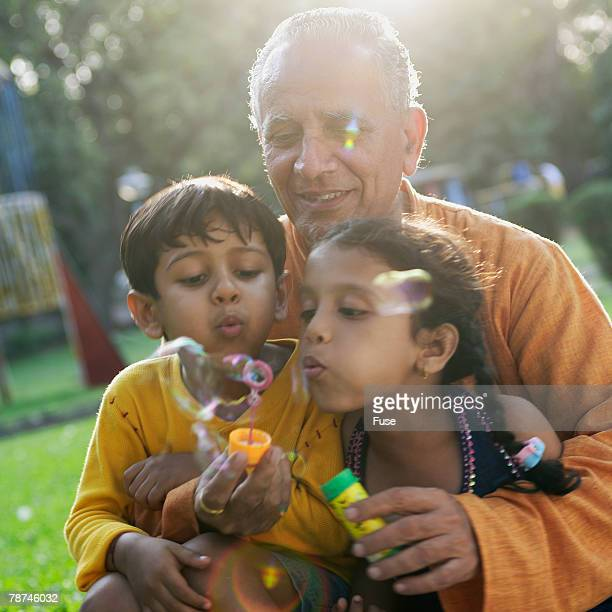 Grandfather With Grandchildren in Park