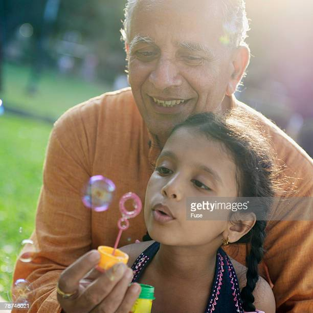 Grandfather With Granddaughter in Park