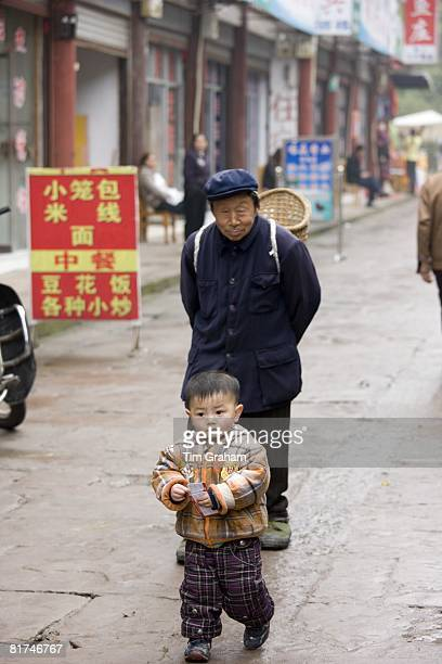 Grandfather with grandson at Baoding Chongqing China has one child family planning policy to reduce population