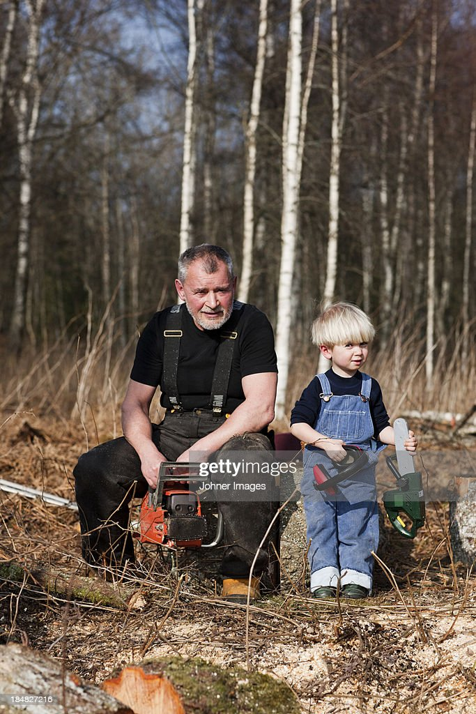 Grandfather with grandson in forest