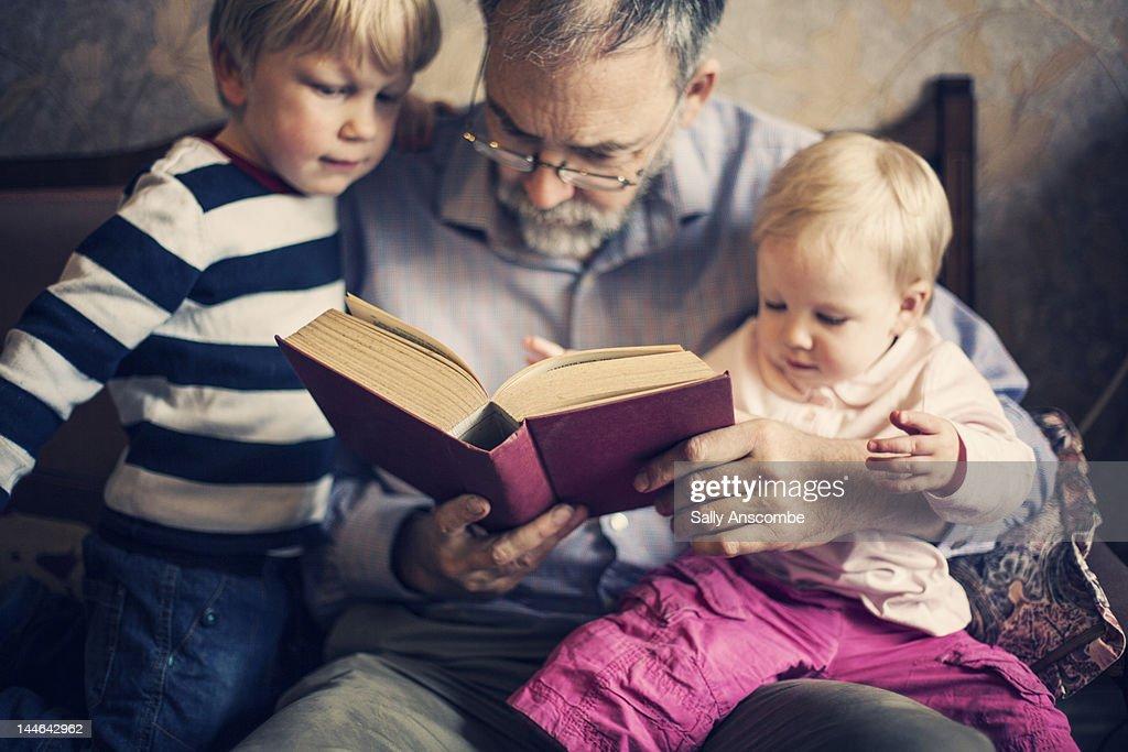 Grandfather with his grandchildren : Stock Photo