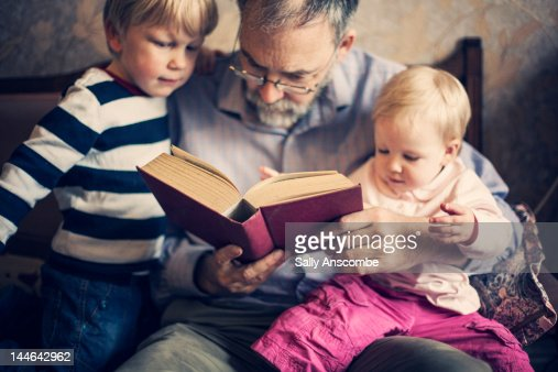 Grandfather with his grandchildren : Stock Photo