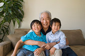 Grandfather with two grandsons