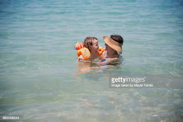 Grandma and boy in the sea