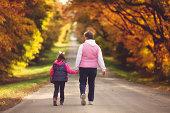 grandma and grandaughter taking walk