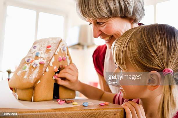 grandma and grandchild baking cake
