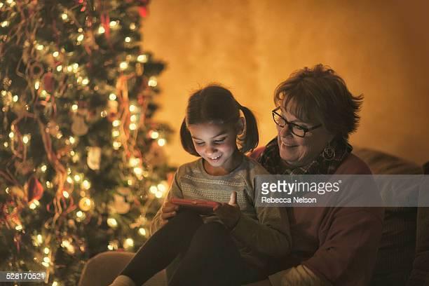 grandma and granddaughter looking at phone
