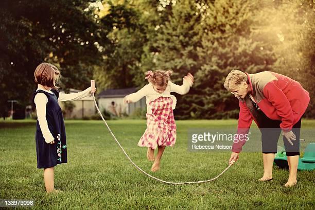 Grandma and granddaughter playing jump rope
