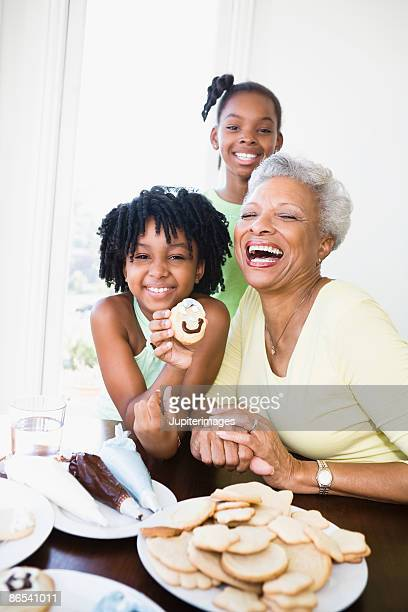 Grandma and granddaughters with cookies