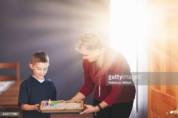 Grandma and grandson holding up pie