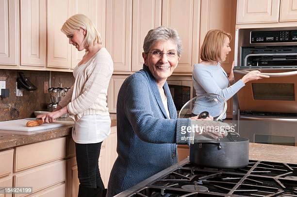 Grandma Cooking with Daughter and Grandaughter