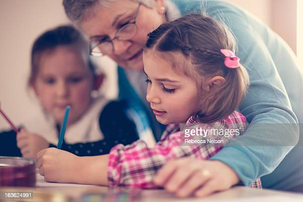 Grandma drawing with her granddaughters